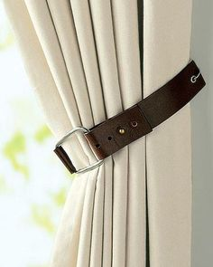 Old belt as a curtain tie-back. Cute for western room or military decor