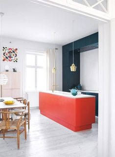 Orange red, tomato red kitchen island and dark teal coloured cabinets paired up . Orange red, tomato red kitchen island and dark teal coloured cabinets paired up against a powder coloured freestanding cabinet, the base is kept white in the apartment. Apartment Kitchen, Home Decor Kitchen, Kitchen Interior, Home Interior Design, Diy Kitchen, Kitchen Layout, Kitchen Ideas, Interior Plants, Kitchen Trends