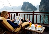 Relaxation on sundeck in Halong Bay, Vietnam - Discover Vietnam with its affordable highlights: Halong bay - UNESCO's World Heritage Site since 1994, Hoian - ancient historic town, Hue - the Imperial capital. Cu Chi tunnels were famous during the Vietnam war, merit our stopover. Enjoy beach escape in Hoian with sun, sand, blue sky...