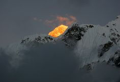"sixpenceee: "" ""At around 5:30 P.M. on a cold evening, the tip of Everest was the last mountain to be illuminated by the setting sun"" Photo by Dylan Toh """