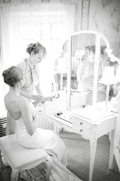 Beautiful bride getting ready, with some help from a friend. Photo by Anna #Minnesota #weddings  http://www.bellagala.com/wedding-photography/about.html