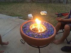 Small and large terracota pot and pot holder from Home Depot. Blue/green glass rocks from local fire pit store.
