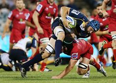 Scott Fardy Photos - Scott Fardy of the Brumbies is tackled during the round one Super Rugby match between the Brumbies and the Reds at GIO Stadium on February 13, 2015 in Canberra, Australia. - Super Rugby Rd 1 - Brumbies v Reds