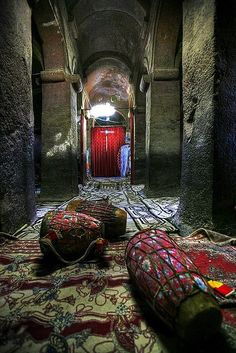 Inside a church in Lalibela, Ethiopia. The church is one of eleven monolithic churches in Lalibela, a city in the Amhara Region of Ethiopia. Carved from solid red volcanic rock in the 12th century.
