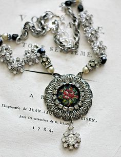 vintage jewelry pieces put together to create a spectacular necklace!