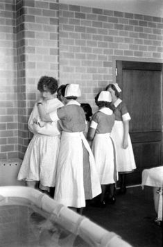 A female patient in restraining jacket Pilgrim Psychiatric Center Brentwood, NY 1938