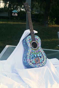 Beautiful mosaic guitar by mosaic artist: Trish Alizade  Berryville, Va,