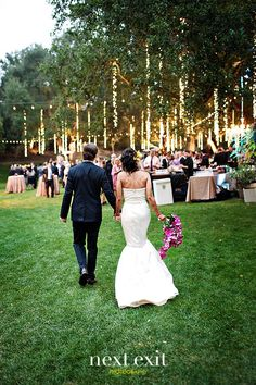 Hang strands of lights straight down from ceiling, trees, doorways, or on walls as wedding decorations...the repetition of vertical lighting pulls the wedding look together and makes it look more expensive.