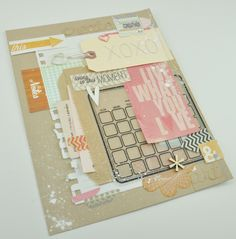a lot of layers, papers, tags, stickers, die cuts, a paper bag that holds the notebook paper with the journaling on it. An Amy Tangerine hand stitched tag. Some washi tapes. A lot of items pulled out of my stash for this one. Love the kraft letters on kraft card stock. must look through