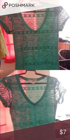 Teal lace tribal v neck t shirt. V neck t shirt, teal, back side has cut out tribal design, front is plain teal, no design on front. Tops