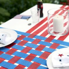 of July Table Runner Cover a table with a white paper tablecloth; snip lengths of blue and red crepe paper to the lengths of the cloth. Weave the colors, as shown; affix at table's edges with double-sided tape. Read more: Fourth of July Party Decor 4. Juli Party, 4th Of July Party, July 4th, 4th Of July Ideas, December, Memorial Day Decorations, 4th Of July Decorations, Table Decorations For Graduation, Rodeo Decorations