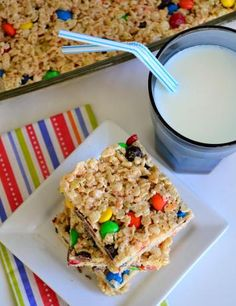 M&M Rice Krispies Treats - 3 T butter, 1 t vanilla, 1 (10oz)  marshmallows, 6  C crispy rice cereal, 1 (12oz)  M&M's:    In large pan melt butter.. Add marshmallows  stir until melted. Stir in vanilla. Remove. Add cereal. Stir until coated. Cool for few minutes. Stir in M&M's. Using wax paper press mix evenly into PAM sprayed 13x9 pan. Cool 15 minutes