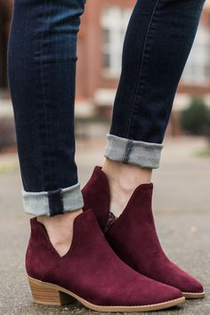 Serve up some Decent Exposure and stunning style with these chic Burgundy Ankle Boots! Your enviable style will be on full display! These faux suede ankle boots feature a pointed toe, side cutouts, and short stacked heel.   • Padded Insole • Non-Skid Sole • Vegan friendly, man made materials • Imported