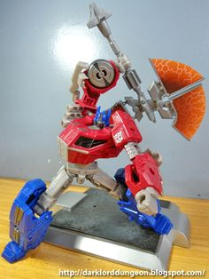 Presenting the Transformers Fall of Cybertron Optimus Prime - wielding the 3rd Party Corbot V Optimus Prime Battle Axe.