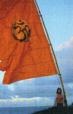 Olivia photographed with the famous 'OM' flag in Switzerland by George in 2001 Olivia Harrison, George Harrison, Linda Eastman, Jane Asher, Pattie Boyd, Om Shanti Om, Wife And Girlfriend, The Beatles, Beach Mat