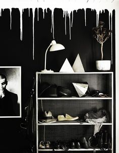 A fab black and white home in South Sweden, I would love to be that brave to do the drippy paint thing!