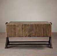 RH's Reclaimed Russian Pine Industrial Coffee Table:Low to the ground, our substantial table is crafted of reclaimed pine from Russia. The planked top is surrounded by a worn and craggy border of dense end-grain timbers. The cast iron base suits its industrial demeanor.