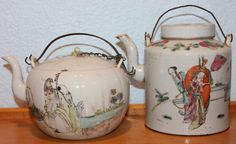 Here's a pair of old antique Chinese 19th century hand painted porcelain teapots with a landscape painting on one side and calligraphy poem on the other side. Maker's mark on the bottom. Acquired at the estate of an antiques collector in the Los Angeles area.