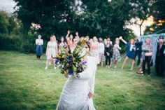 Wild Bouquet   Bohemian Marquee Wedding in Norfolk   Bride in Elizabeth Avey   Bridesmaids In Floral Skirts   Photography by Tim Dunk   http://www.rockmywedding.co.uk/jessica-chris/