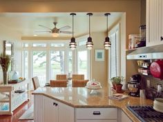 The home's former dining area finds new life as a gourmet kitchen, complete with cottage-style maple cabinetry and natural quartz countertops.