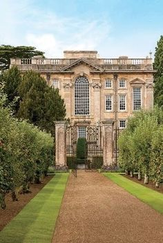 Rows of apple trees lead to the entrance of Easton Neston, Northamptonshire, the 1702 masterpiece by Nicholas Hawksmoor, an ingeniously inventive architect who also had a hand in Blenheim Palace and Castle Howard. From its stone lions marching along the roofline to its wildly attenuated windows, the ashlar building represents the domestic high point of the English Baroque, a flamboyant style that flowered briefly before Palladian stateliness became prominent.