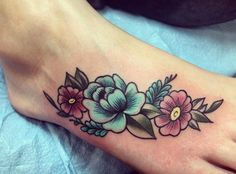 Floral tattoos are every girl's best friend. And this gorgeous neo traditional foot piece is no exception. The soft lines and unique shading make this piece a pleasure to view.