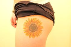 """this is exactly what I want the one on my back to look like! with """"imagine"""" in one of the lower right petals."""
