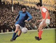 b9cfffaa87b Manchester United winger George Best running at Arsenal captain and rookie  centre