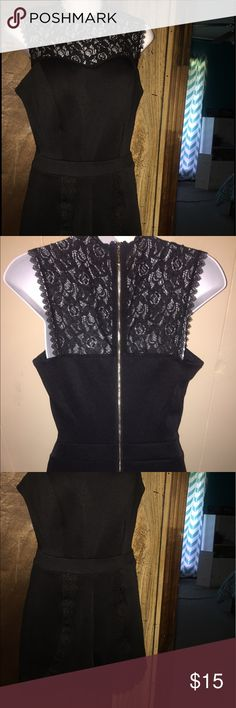 Beautiful, sleek black romper beautiful black romper , never worn . Perfect condition , size medium . The zipper goes down the back so it's simple to get in and out of ! Dresses