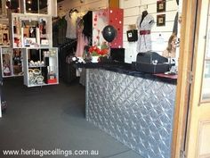 Counter in the Black Sheep Booteek.  The Lattice pressed tin design was used to clad the counter at this boutique. For more pressed tin designs see: http://www.heritageceilings.com.au/tin-ceilings-patterns.php