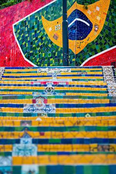 View of Selaron's Stairs (Escadaria Selarón), a colorful mosaic tile stairway, in Rio de Janeiro, Brazil, 12 February 2012. World-famous staircase, mostly covered by vibrant yellow, green and blue tiles (inspired by the colors of the Brazilian flag), is the masterpiece of Chilean-born artist Jorge Selarón who considers it as a personal tribute to the Brazilian people. Connecting the neighborhoods of Santa Teresa and Lapa, the stairway is made up of 250 steps and measures 125...