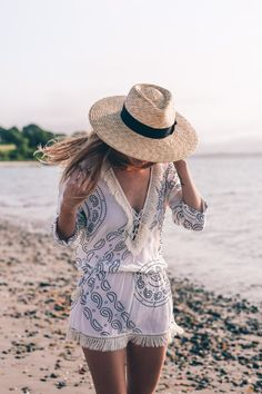 Summer beach style, a coolchange fringe tunic and straw boater hat styled by Jess Kirby.