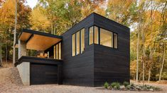 Studio MM Architect has created a holiday dwelling in upstate New York, which features a giant front door and a garage for its car-lover owner.
