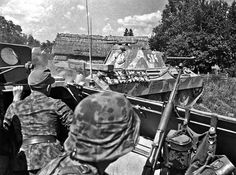 """Panzergrenadiers of Kampfgruppe Mühlerkamp (Gerhard Mahn on left) of 5.SS-Panzer-Division """"Wiking"""" take cover in their SPW SdKfz 251 as Panther 534 passes by them, Nurzec-Stacja, 22nd July 1944"""