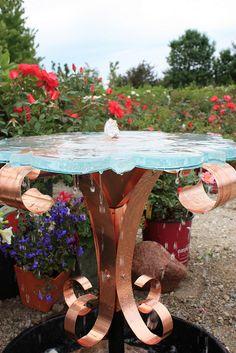 Cast glass garden fountain by Studio L Glassworks.