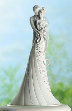 "Cake topper. The writing on her dress says ""This day I will marry my friend, the one I laugh with, live for, dream with, love."""