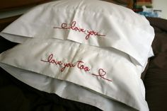 little love notes embroidered onto pillow cases.