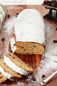 Stollen - A slightly sweet German yeast bread packed with rum soaked fruit and marzipan. Dusted with powder sugar for a winter look. Get the recipe at Roxanashomebaking.com