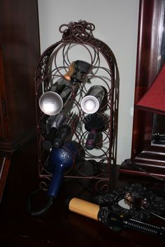 Use a wine rack to house your curling irons, hair sprays, brushes, ect!