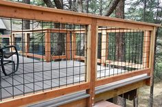 Wild Hog brand metal deck railing installed on a deck in Kachina Village near Flagstaff Arizona.  The railing consists of black painted welded wire on a 4 inch by 4 inch grid.