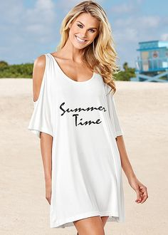 Cozy up in this loose-fitting cover-up! Venus cold shoulder graphic tunic.