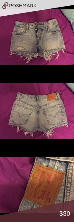 NWOT High Waisted Levi's These are brand new. I bought them for vacation and sadly were too small. These are so cute and the perfect light wash. 501 style, buttons instead of a zipper, beautifully distressed. No size but I believe it said 25 before I ripped the tags off, anyways would fit a size 24/25. Perfect for the upcoming weather! Measurements upon request Levi's Shorts