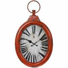 """Iron wall clock with an antique orange finish and pocket watch-inspired silhouette. Product: Wall clockConstruction Material: Iron and glassColor: Antique orangeAccommodates:  (2) AA Batteries - not included   Dimensions: 30"""" H x 16.5"""" W x 2"""" D Cleaning and Care: Dry wipe clean"""