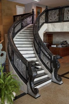 This curved staircase design features two seahorse carvings. Click on the picture to take a closer look. #Stone #Carving #Design #Staircase #Art