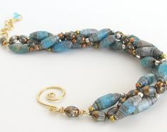 Handcrafted Beaded Bracelet with Blue Paper Beads. Handmade in USA by PurpleDotBoutique. Available on Etsy.