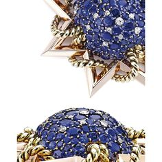 TWO-COLOR GOLD, SAPPHIRE AND DIAMOND BROOCH, PAUL FLATO Designed as a star accented by a gold ropetwist, the center of bombé form, set with round, oval and cushion-cut sapphires, accented by old European-cut diamonds weighing approximately 1.05 carats, gross weight approximately 59 dwts, signed Flato; circa 1940. With signed box.