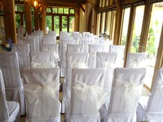 Our vanilla organsa chair bows look beautiful on white linen chair covers.  Styled at Rivervale Barn, Yateley wedding venue by www.fuschiadesigns.co.uk.