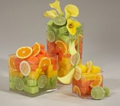 Fresh fruit wedding centerpieces using whole or sliced fruit.one of the best budget wedding ideas for or your spring or summer wedding. Summer Wedding Centerpieces, Edible Centerpieces, Wedding Reception Decorations, Wedding Ideas, Tropical Centerpieces, Fruit Centerpiece Ideas, Wedding Table, Reception Ideas, Trendy Wedding