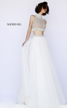 SHERRI HILL Prom Dresses 2015 # 11220 Soft and delicate, this metallic two-piece ball gown features a high neck halter top of pearls, French beads and rhinestones, then paired with a whisper soft tulle skirt.