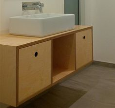 Plywood Vanity with circle cutouts